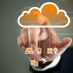 person tapping on orange cloud with different tech icons dangling from the cloud